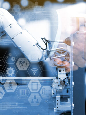 Industry 4.0 concept .Two Business people shaking hands with industry graphic sign and blue tone of automate wireless Robot arm in smart factory background. Double exposure ,blue tone